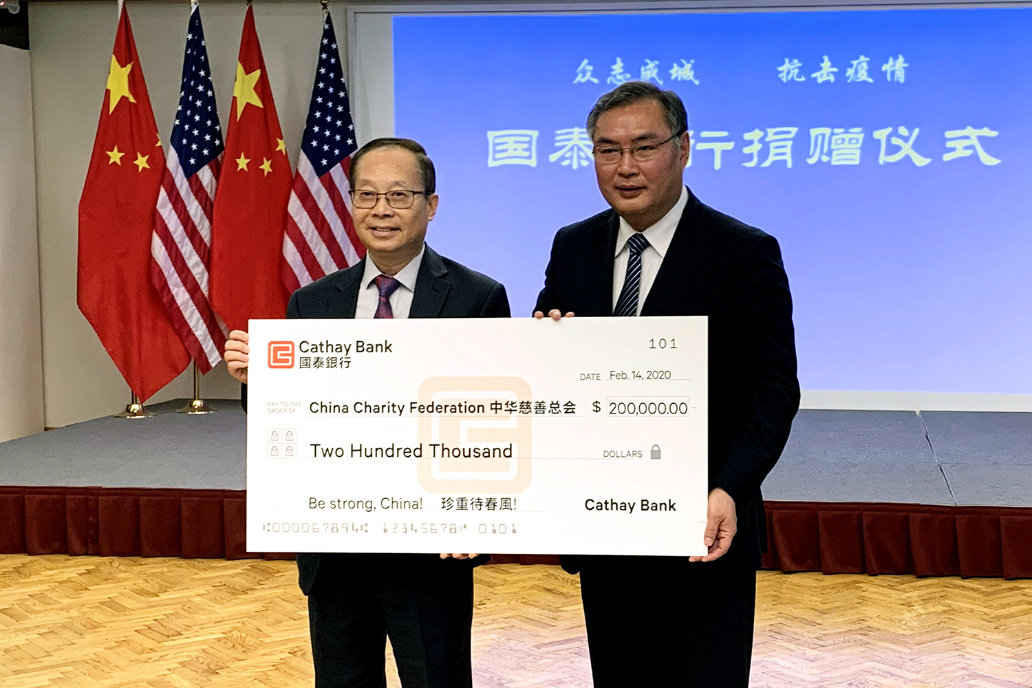 Pin Tai (left), Chief Executive Officer of Cathay Bank, presented donation check to Zhang Ping (right), the Consul General of the Consulate General of the People's Republic of China in Los Angeles, in support of the coronavirus control efforts in China.