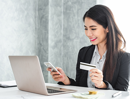 Young asian businesswoman in suit using smart phone and credit card for online shopping, internet banking and buying service from the internet.