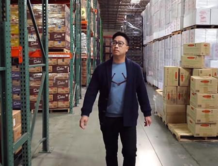 Jans Enterprises Corp. CEO Anthony Kartawinata working in his company's warehouse.